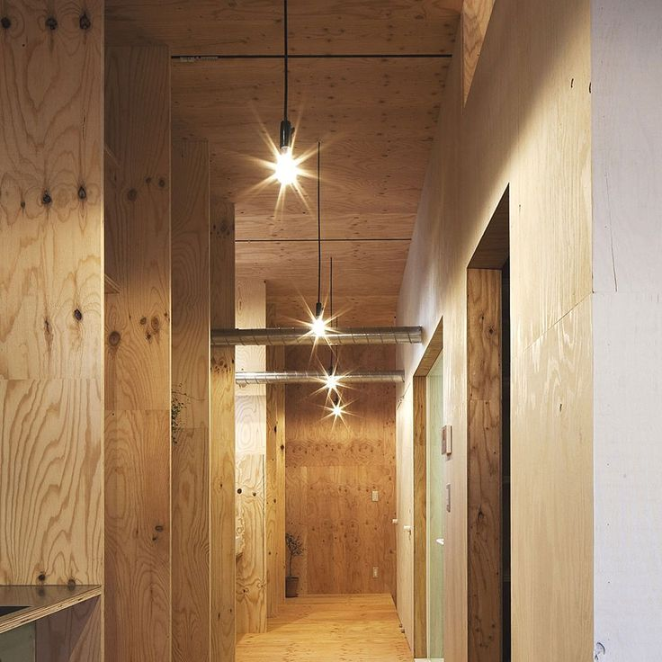 Interior yellow timber hallway design the ant house