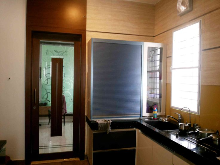 Large kitchen with window Blinds, Designed by Ar.Mohanraj annakodi, Architect in Coimbatore, Tamil Nadu, India.