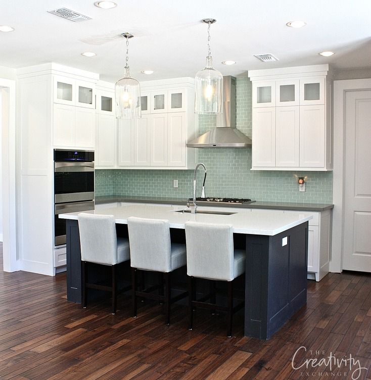 Cabinet color is Decorator's White and Island is Wrought Iron both Benjamin Moore.  Looks very good with green or teal colors