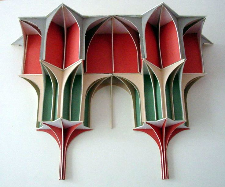 A cardboard muqarnas model I made several years ago. I made horizontal tiers and connected with arched vertical sections. Islamic geometric design