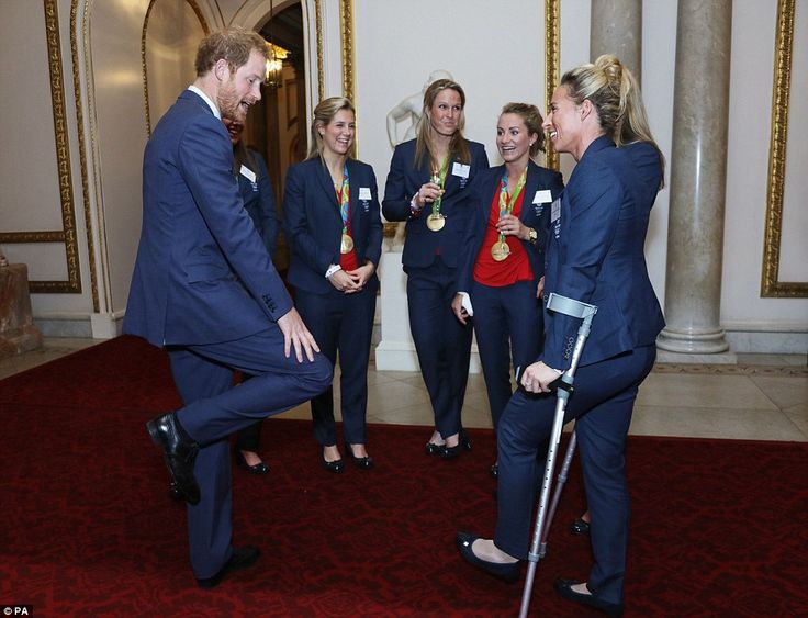 Prince Harry appeared to be joking about how one of the hockey players was using crutches and pointed towards his knee