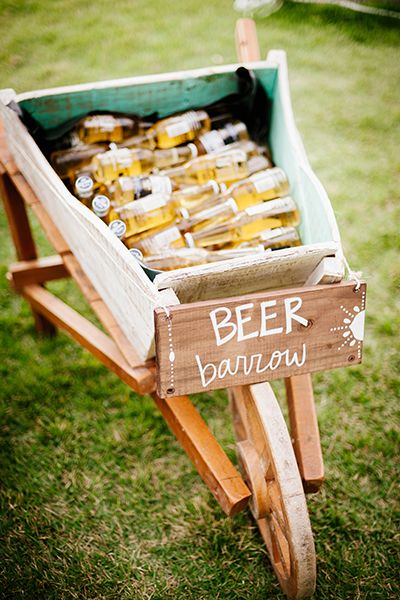Display beer bottles in a wheelbarrow! Perfect for a rustic wedding