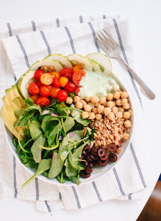 A colorful and hearty Greek-inspired salad featuring farro, chickpeas, mint-dill yogurt sauce and plenty of greens.