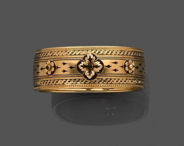 Bracelet ruban en or jaune (750 millièmes) et émail noir, ouvrant et articulé à [...], Bijoux et Montres à Leclere - Maison de Ventes | Auction.fr