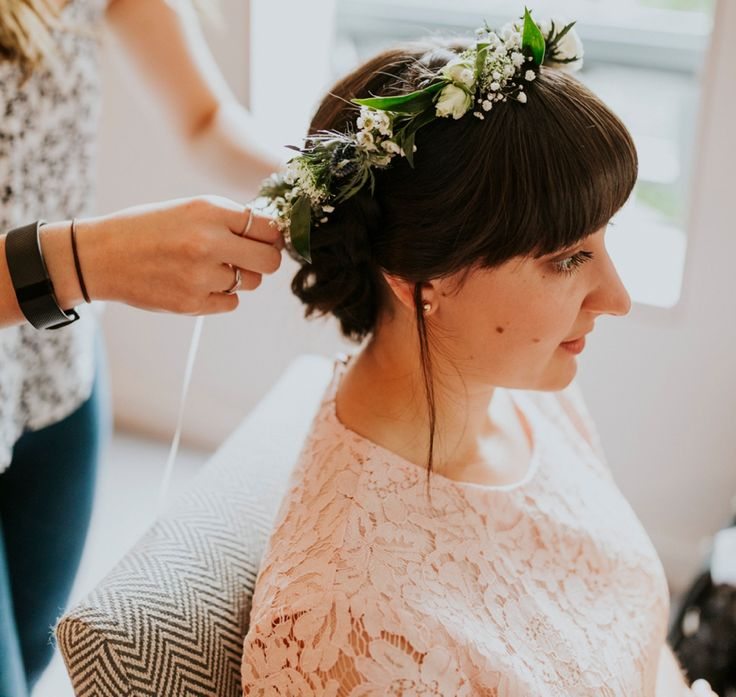 Thistles, gyp, roses and greenery are the perfect base of a fabulous flower crown. Photo by Benjamin Stuart Photography #weddingphotography #flowercrown #bridesmaid #weddinghair #hairup