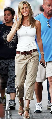 ♥ Jennifer Aniston..doesn't she make the simplest outfit look remarkable?  white tank top, boyfriend khakis and wedges never looked so good!