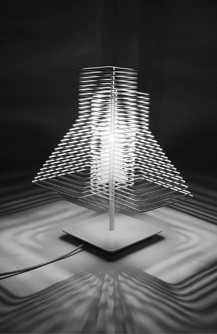 Grown - Table Lamp - A lamp created from a sequence of wire thread that will rhythmically play with the light: it will cut it, amplify it, disturb it, draw it.