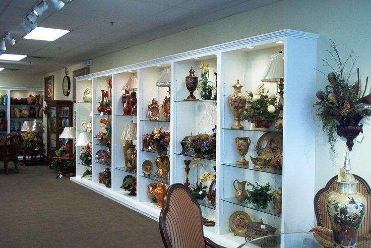 Accessories sparkle in this white and glass display unit.