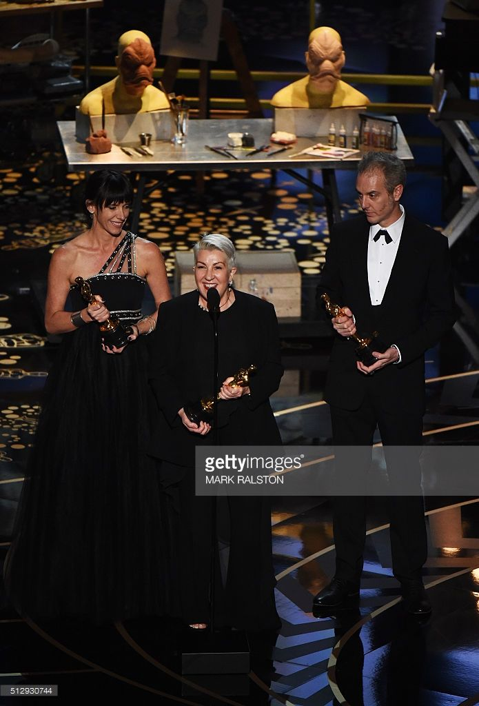 Elka Wardega (L), Lesley Vanderwalt (C), and Damian Martin accept the award for Best Makeup and Hairstyling, Mad Max: Fury Road on stage at the 88th Oscars on February 28, 2016 in Hollywood, California. AFP PHOTO / MARK RALSTON / AFP / MARK RALSTON