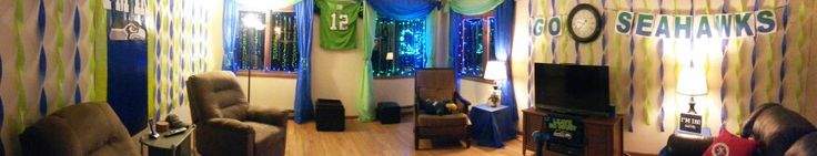 Seattle Seahawks Super Bowl Party 2015. Living hundreds of miles from a big city, I had to get creative with only plastic table covers, four rolls of streamers, curling ribbon and holiday lights. Raised the 12th man flag over my daughter's blue plastic Space Needle souvenir cup.