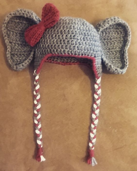Crochet Alabama Elephant Hat Ear flap hat pattern : http://allicrafts.blogspot.com/2011/01/free-pattern-baby-earflap-hat-3-months.html?m=1 Bow pattern modified from here: http://www.craftinessisnotoptional.com/2013/01/easy-crochet-bow-tutorialpattern.html Couldn't find a pattern I liked for ears, but this is what I did: Crocheted by K Olds. Using 2 strands of worsted weight yarn and I/9 hook, Chain 7. R1: Dc 3rd Ch from hook and each st across (5) (ch 3 counts a...:
