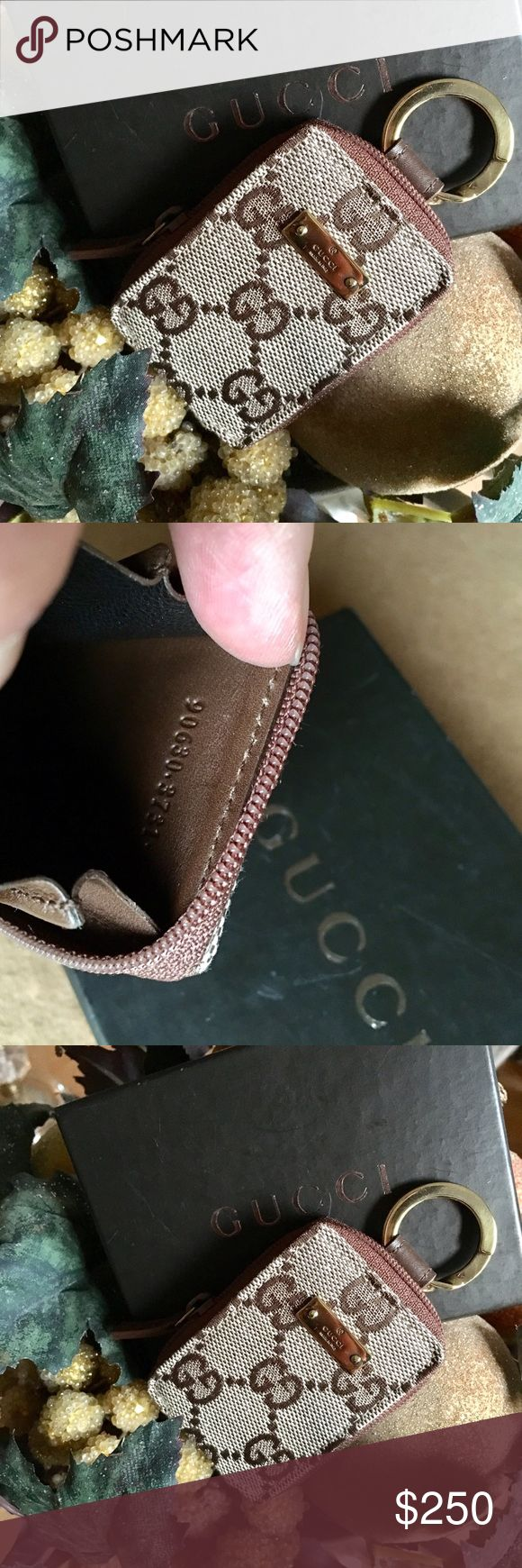 Gucci coin purse key ring Practically new- owned by me, and sadly, not used. I came across it in my dresser recently when spring cleaning so I will let it go. Gorgeous signature canvas coin purse with brown leather interior. Accented by a gleaming gold key ring. Please see second photo for Gucci code. Comes in the original box. Gucci Accessories Key & Card Holders