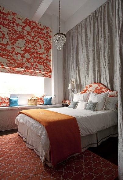 What a cool room Giant Asian roman shade Grey silk curtain behind bed Crisp linens Pretty rug. I love orange!