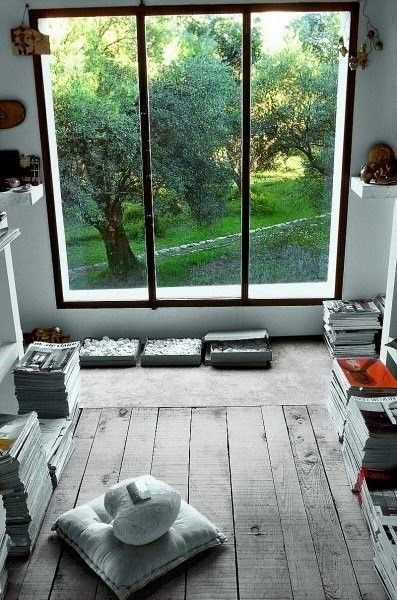 Love the big window and the colour of the wooden floor