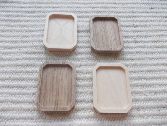 4pc unfinished rectangle shaped pendant/brooch base with slightly cut corners,rectangle base bezel cup,rectangle picture frame.  ooden rectangle shaped pendant/brooch base for jewel making. In the centre of the pendant there is a rectangle-shaped cabochon frame/cutout  https://www.etsy.com/listing/191204103/4pc-unfinished-rectangle-shaped?ref=related-0