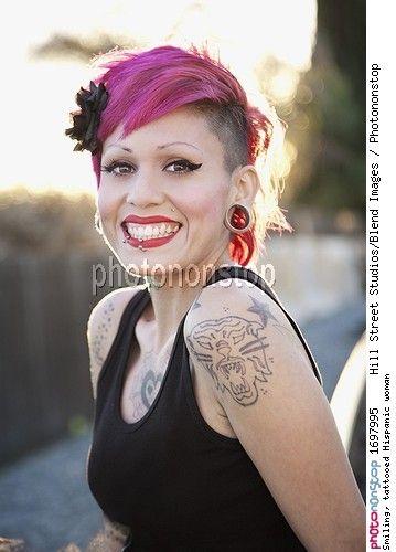 Smiling, tattooed Hispanic woman