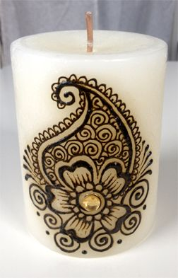 Henna decorated candle.