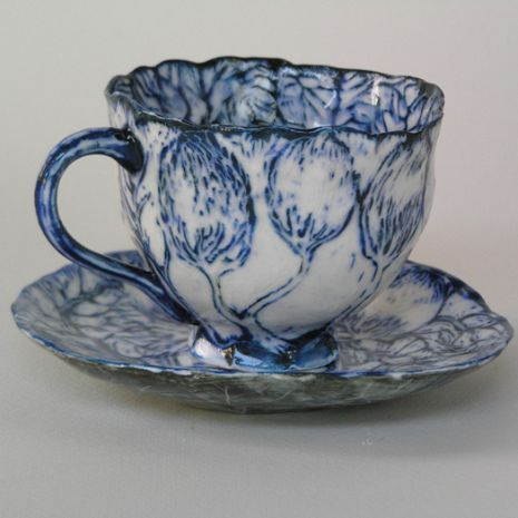 Gerry Wedd Cheers, 2010 Cool ice porcelain In the collection of Northcote Pottery Supplies Image credit: courtesy of the artist.  Based in Adelaide, Gerry Wedd is a ceramacist renowned for his wheel thrown, slip and cobalt decorated ceramics. Cheers is an excellent recent example of this and the work was acquired by Northcote Pottery Supplies through their annual Ceramic Art Award.
