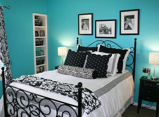 Black & white bedding with blue/teal walls