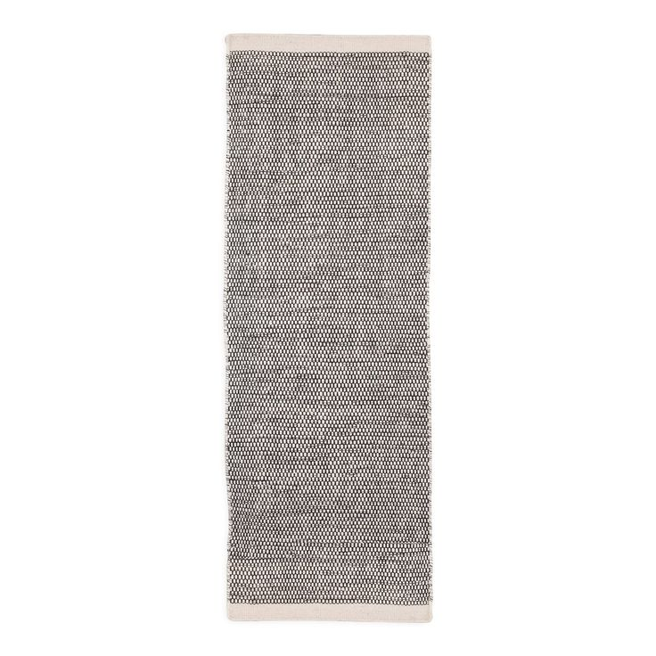 A luxurious, rustic, hand-woven rug, the Asko is crafted for the modern interior using a beautiful blend of woollen fibres. A striking example of traditional Scandinavian craft, this minimal rug exemplifies Linie Design's penchant for combining Danish heritage with contemporary style.
