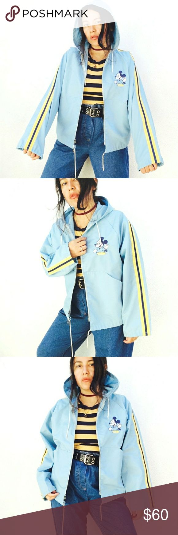 Rare 70s pastel blue Mickey oversized windbreaker Rare and awesome 70's pastel baby blue Disney hooded windbreaker bomber jacket. Size Medium.  You gotta love the color and the sporty vibe of this beauty: powder blue with pastel yellow stripes at sleeves. Lightweight, perfect for all year around.  Features embroired retro Mickey Mouse at chest, big arse hood, zip front close, unusual hidden pockets at sides, semi flare sleeves and waist cord.  Priced acordingly to age and rareness. Believe…