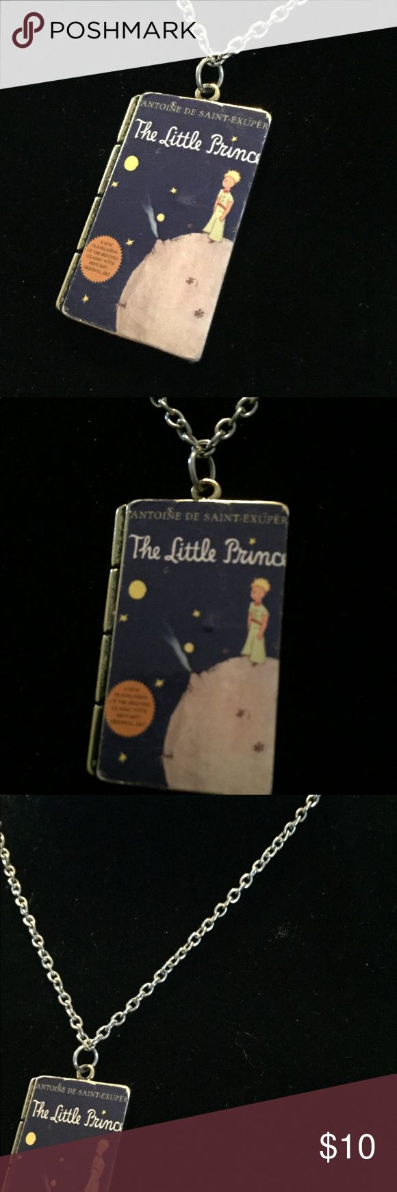 "Cult Of Personality, The Little Prince Necklace Cult Of Personality, The Little Prince Necklace. The Pendant On This Necklace Is The Cover From Antoine De Saint Exupery's The Little Prince, In Full Color.    It's Set On A Metal Base.  The Pendant Measures 1.5"" Long x 1"" Wide.  The Necklace Chain Measures 22"" And Is Fully Adjustable To Any Size.  Lobster Clasp.  New With Tags.  Four of these are currently available. Emporiama's Cult Of Personality Jewelry Necklaces"