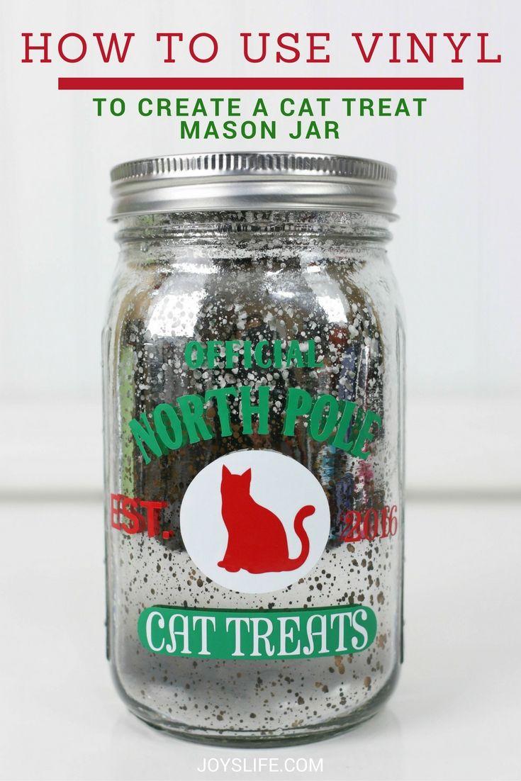 Learn how to use vinyl to create a cat treat mason jar! So cute for pet treats!  AD #PAWsomeGifts #ClausAndPaws @walmart  #silhouettecameo #vinyl  #vinyltutorial #cat #masonjar #christmas
