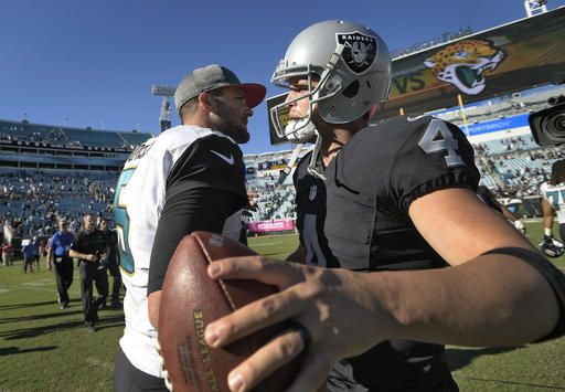 Raiders vs. Jaguars:     October 23, 2016  -  33-16, Raiders  -    Oakland Raiders quarterback Derek Carr (4)  shakes hands with Jacksonville Jaguars  quarterback Blake Bortles after the Raiders  defeated the Jaguars 33­16 during an NFL  football game Sunday, Oct. 23, 2016, in  Jacksonville, Fla. (AP Photo/Phelan M.  Ebenhack)