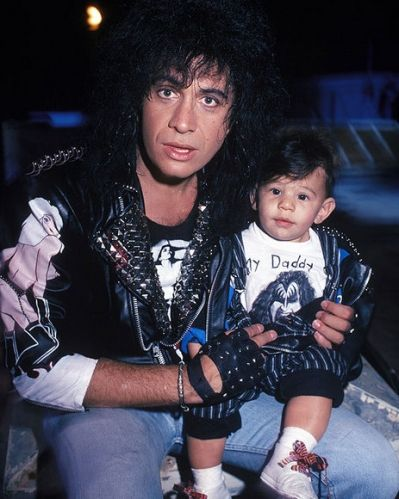 Gene Simmons with son Nicholas - who is rocking a Kiss t-shirt and leather jacket - backstage at a Kiss concert in 1988.
