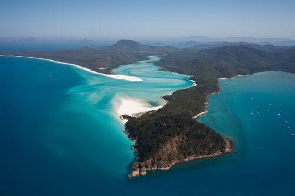 Nestled amongst the swaying palms fringing the white-sand beach and the glistening turquoise waters of Long Island (Whitsunday Islands) lies Palm Bay. A picturesque sweeping bay you can approach it through the dredged channel and lagoon and offers a safe overnight anchorage. From here the visiting yachtsman can take advantage of the bays exclusive and intimate resort, Pepper Palm Bay.  Head further inland and explore the islands National Park by taking one of the many tracks and trails.