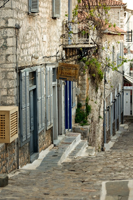 Hydra, Greece I've been here, it's an island and I bought beautiful pottery, and I remember they had dead birds with all the feathers still on, hanging out side in the marketplace (chicken, ducks, geese) Loved the narrow alleys!