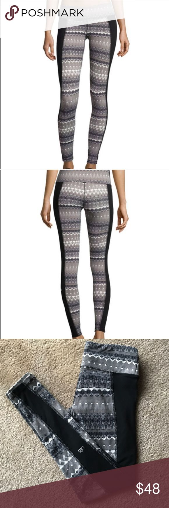 ALO Yoga illusion 3 arctic viridian black leggings Excellent used condition, no pilling, rips, or stains. Size small. Rip tag has been removed from inside. Super cute black and gray tribal print with black paneling on sides. High performance athletic fabric that wicks sweat and dries quickly. Pocket in waistband. ALO Yoga Pants Leggings