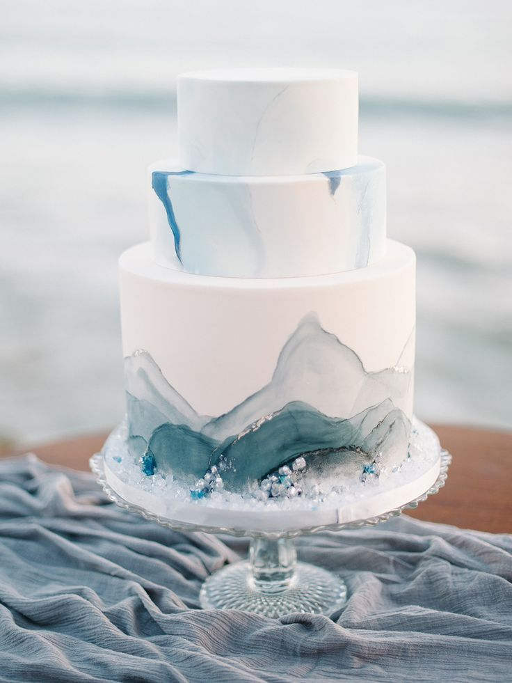 wedding cake with blue accents - http://ruffledblog.com/malibu-coastal-bohemian-wedding-inspiration #weddingcake #cakes