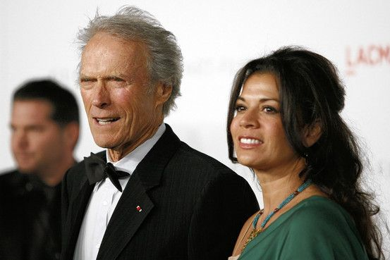 The only famous person I have met who looks better in person than on screen. His wife Dina Eastwood.