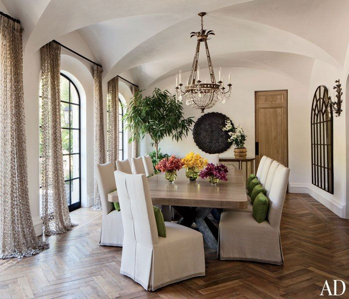 Gisele Bündchen and Tom Brady's Los Angeles Home  DINING ROOM A chandelier and sconce by Dennis & Leen grace the dining room; the curtains are made of a fabric by Marcie Bronkar, and a Kerry Joyce linen covers the chairs by Behnke, who also designed the table.