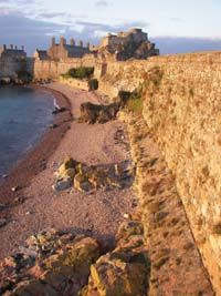 Elizabeth Castle Walls - Jersey, Channel Islands. Sir Walter Raleigh Governor of Jersey between 1600 and 1603 named the castle after Elizabeth I of England, You can now stay in an apartment within the castle