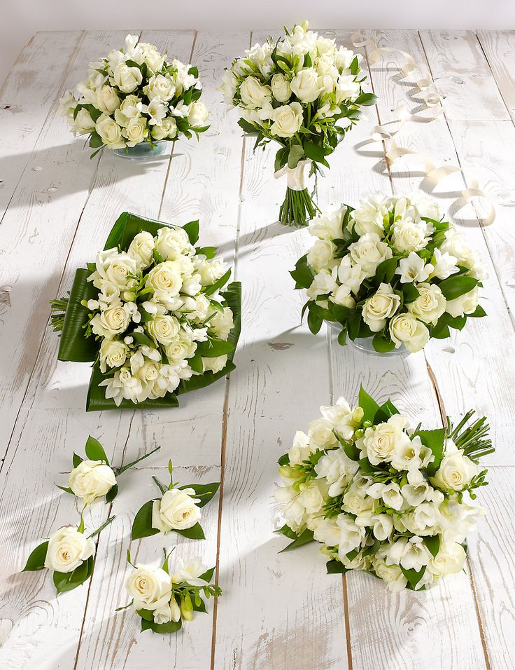 These beautiful white rose & freesia wedding flowers would make your big day one to remember.