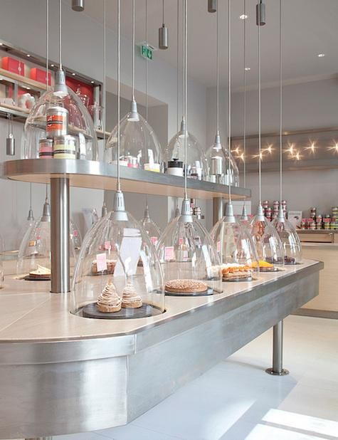 La Patisserie des Reves in Paris, Glass temperature controlled domes cover the cakes. The silver cylinder is the weight holding the cord in place.