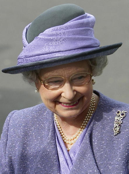 The Queen wearing the Bridge Amethyst brooch.