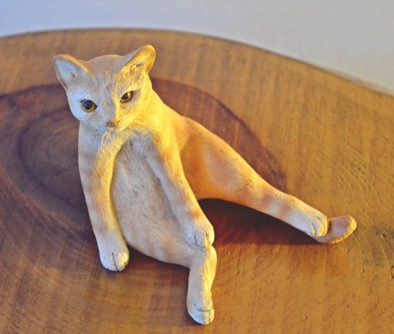 Check out this item in my Etsy shop https://www.etsy.com/ca/listing/500500935/chillin-orange-tabby-figurine-resin-cat