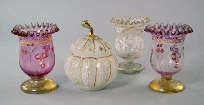 A Turkish milk glass melon form jar and cover, late 19th/20th century, Beykoz, decorated with gilt lines and stylised scrolls, 14cm. high, together with three vases, of similar date(4)