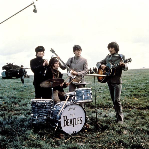 John Lennon, Richard Starkey, Paul McCartney, and George Harrison filming Help!