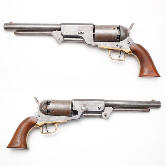 The Heavy Holy Grail of Colt Revolvers- The rare Colt Walker Model 1847 is a 6-shot, single-action revolver weighing in at 4-1/2 lb & measuring a 1-1/2' in length. It was the weighty brainchild of Samuel Colt & Samuel Walker. Walker met with Colt in the 1840s to propose improvements to the Colt Paterson revolver...the result was the Colt Walker. Fewer than 10% of the 1,100 are known to exist today. Due to their rarity, these guns are the Holy Grail of Colt revolver collecting. NRA Museums.