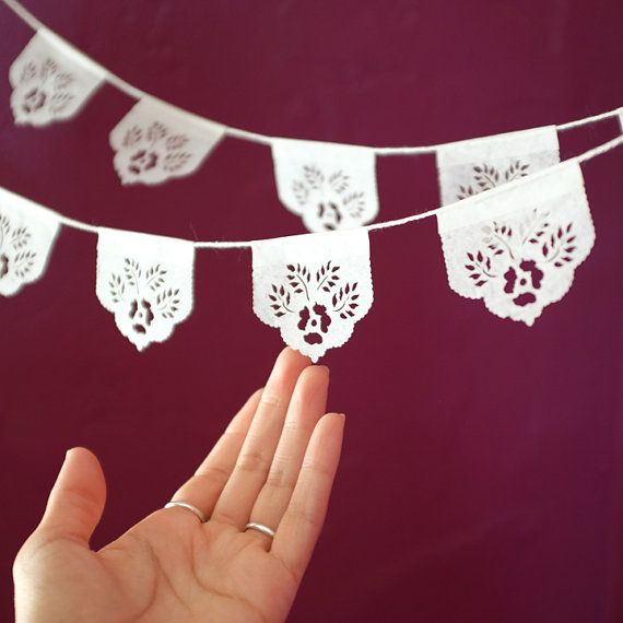 "Packaged in sets of two strands.  Each mini banner is 20"" long, with (6) tiny flags  Available in white or mixed brights.      ▶ ABOUT OUR LAS FLORES"