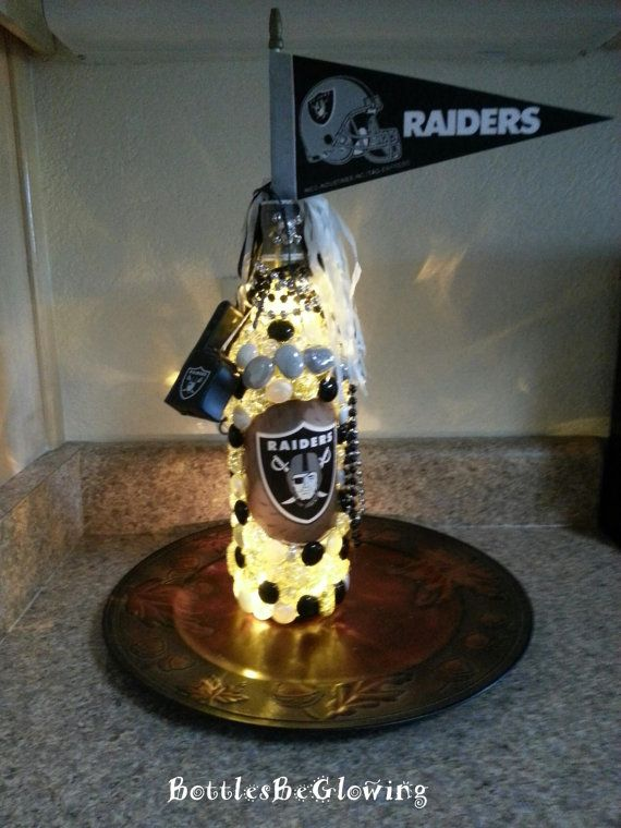 WANT IT!!!! Oakland Raiders Wine Bottle Light by BottlesBeGlowing on Etsy, $25.00