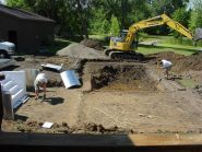 We start by excavating your backyard.