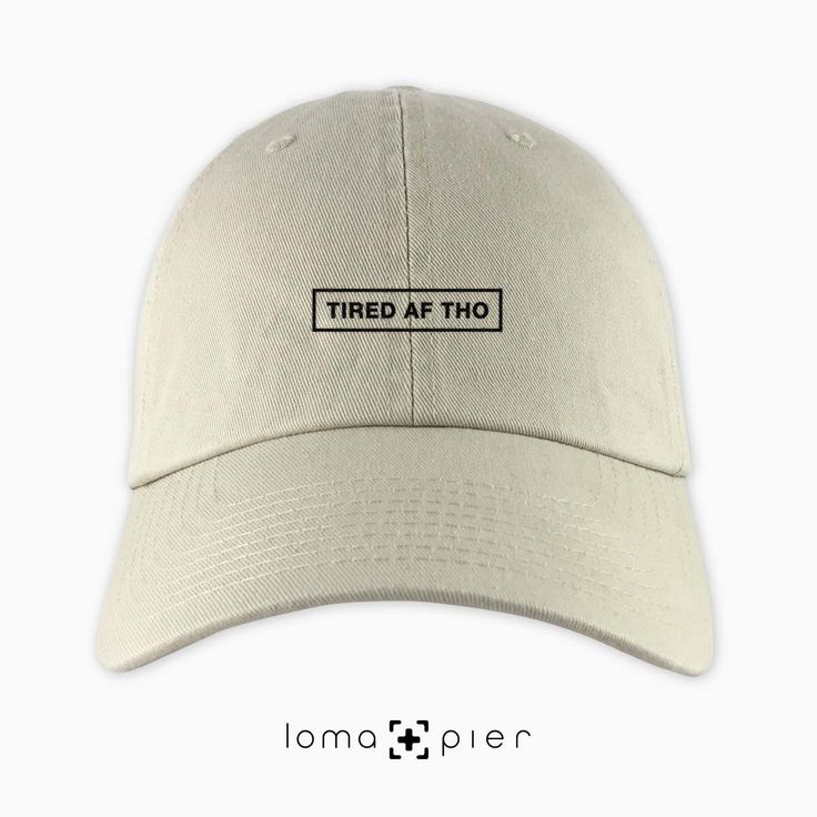 TIRED AF THO typography embroidered on a khaki unstructured dad hat with black thread by loma+pier hat store made in the USA. TIRED AF THO dad hat is 100% cotton unstructured with a pre-curved bill and an adjustable self strap with a hide-away side buckle. it features TIRED AF THO typography embroidered on the front with a small loma+pier logo on the left side. each order is custom made in the USA and can only be found in the loma+pier hat store.