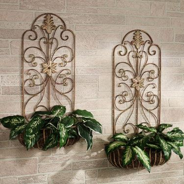 The metal Carrolton Indoor/Outdoor Wall Planter Set features decorative  pieces that can hold your faux greenery in style. Wall