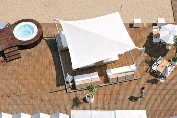 Intrepid - beautiful retractable sail awnings, designed and manufactured in Italy, derived from genuine nautical technology. For private and commercial spaces. Seaside resort, Italy.
