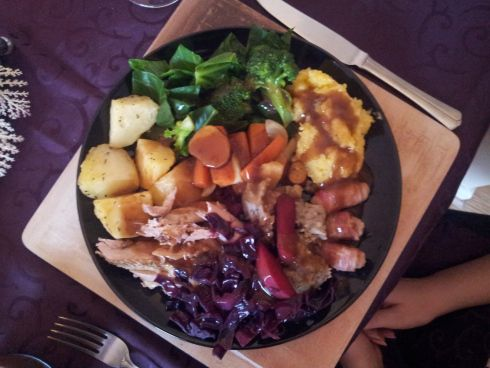 #hollyheartsfood: My perfect roast dinner for two... Roast pheasant, served with Herbes de Provence  seasoned roast potatoes; braised red cabbage; mashed swede; honey & mustard glazed carrots, parsnips and sweet potatoes; steamed broccoli and spring greens; and some cheating trimmings… pigs in blankets from Tesco and pork stuffing with caramelised chestnuts from M&S Food; all smothered in a rich gravy made from my veg stock and game drippings.